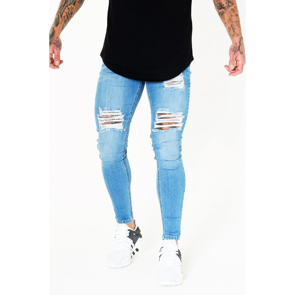 Sinners Attire Ripped & Repaired Jeans - Light Blue